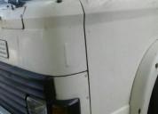 Excelente camión ford 10 10 con volcadora