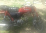 Vendo excelente moto andando impecable